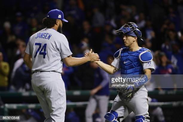 Kenley Jansen and Austin Barnes of the Los Angeles Dodgers celebrate after beating the Chicago Cubs 61 during game three of the National League...