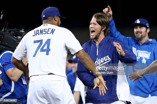 Kenley Jansen and Clayton Kershaw of the Los Angeles Dodgers celebrate after the Dodgers defeat the Atlanta Braves 43 in Game Four of the National...