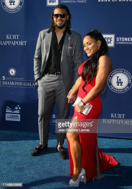 Kenley Jansen and Gianni Jansen attend the 5th Annual Blue Diamond Foundation at Dodger Stadium on June 12 2019 in Los Angeles California