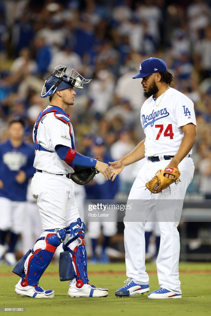 Kenley Jansen #74 and Yasmani Grandal #9 of the Los Angeles Dodgers celebrate after the Dodgers defeated the Arizona Diamondbacks in Game 1 of the National League Division Series at Dodger Stadium on Friday, October 6, 2017 in Los Angeles, California.