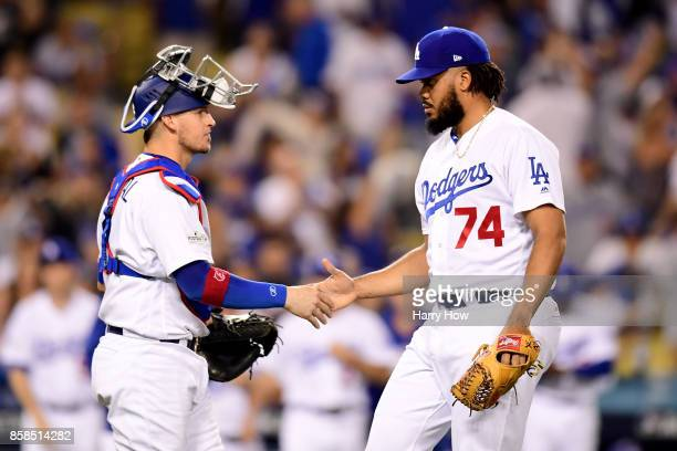 Kenley Jansen and Yasmani Grandal of the Los Angeles Dodgers celebrate the Dodgers 95 victory in game one of the National League Division Series...