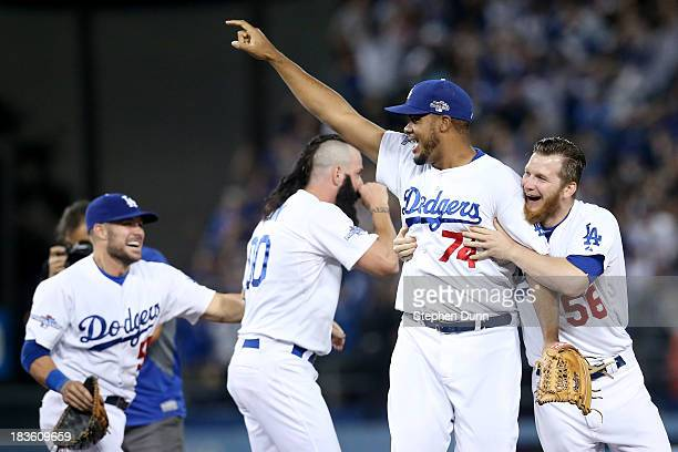 Kenley Jansen Brian Wilson JP Howell of the Los Angeles Dodgers celebrate after the Dodgers defeat the Atlanta Braves 43 in Game Four of the National...