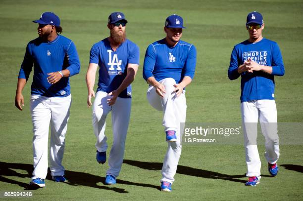 Kenley Jansen Josh Fields Luis Avilan and Kenta Maeda of the Los Angeles Dodgers stretch in the outfield prior to Game 1 of the 2017 World Series...