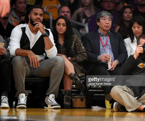 Kenley Jansen of the Los Angeles Dodgers and his wife Gianni Jansen along with biotech billionaire Patrick SoonShiong and his wife Michele B Chan...