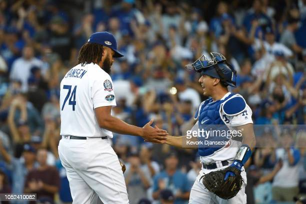Kenley Jansen of the Los Angeles Dodgers celebrates with Austin Barnes after they defeated the against the Milwaukee Brewers 52 in Game Five of the...