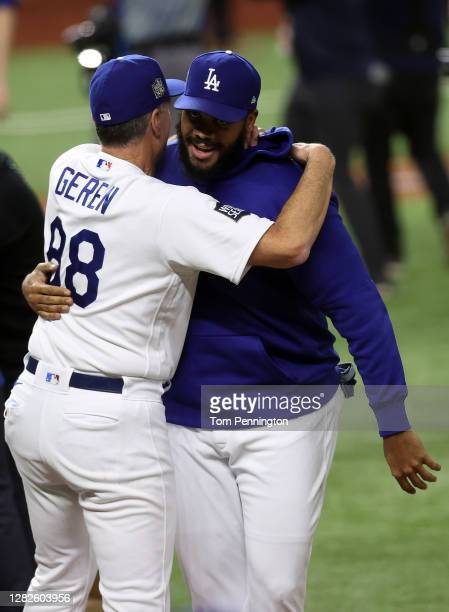 Kenley Jansen of the Los Angeles Dodgers celebrates with bench coach Bob Geren after defeating the Tampa Bay Rays 3-1 in Game Six to win the 2020 MLB...