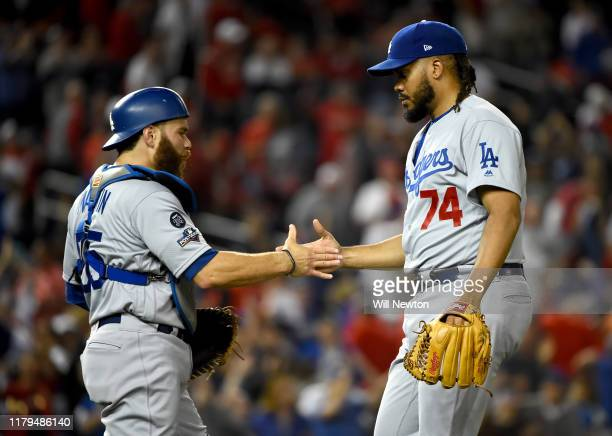 Kenley Jansen of the Los Angeles Dodgers celebrates with catcher Russell Martin after the final out of Game 3 of the NLDS to defeat the Washington...