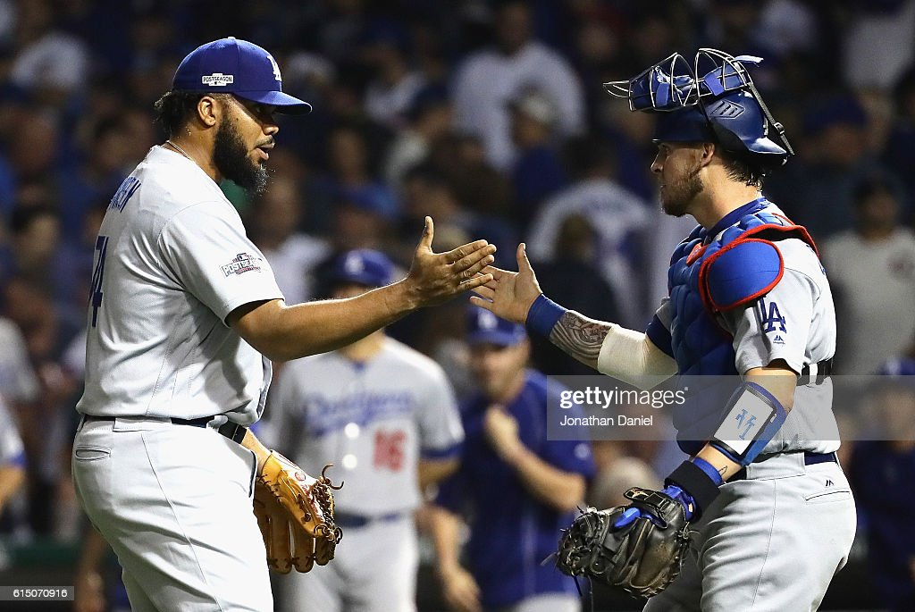 Kenley Jansen #74 of the Los Angeles Dodgers celebrates with Yasmani Grandal #9 after defeating the Chicago Cubs 1-0 in game two of the National League Championship Series at Wrigley Field on October 16, 2016 in Chicago, Illinois.