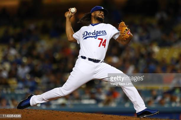 Kenley Jansen of the Los Angeles Dodgers delivers a pitch against the San Francisco Giants during the ninth inning at Dodger Stadium on April 02 2019...