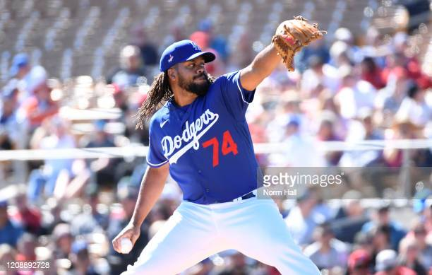 Kenley Jansen of the Los Angeles Dodgers delivers a pitch during the first inning of a spring training game against the Los Angeles Angels at...