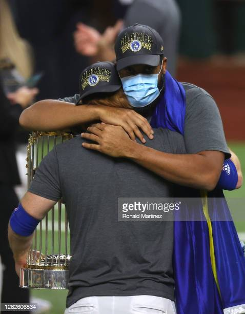 Kenley Jansen of the Los Angeles Dodgers embraces Justin Turner after the teams 31 victory against the Tampa Bay Rays in Game Six to win the 2020 MLB...