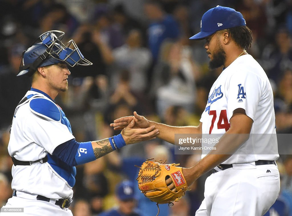 Kenley Jansen #74 of the Los Angeles Dodgers gets a handshake form Yasmani Grandal #9 of the Los Angeles Dodgers after a save in the ninth inning of the game against the Philadelphia Phillies at Dodger Stadium on April 28, 2017 in Los Angeles, California.