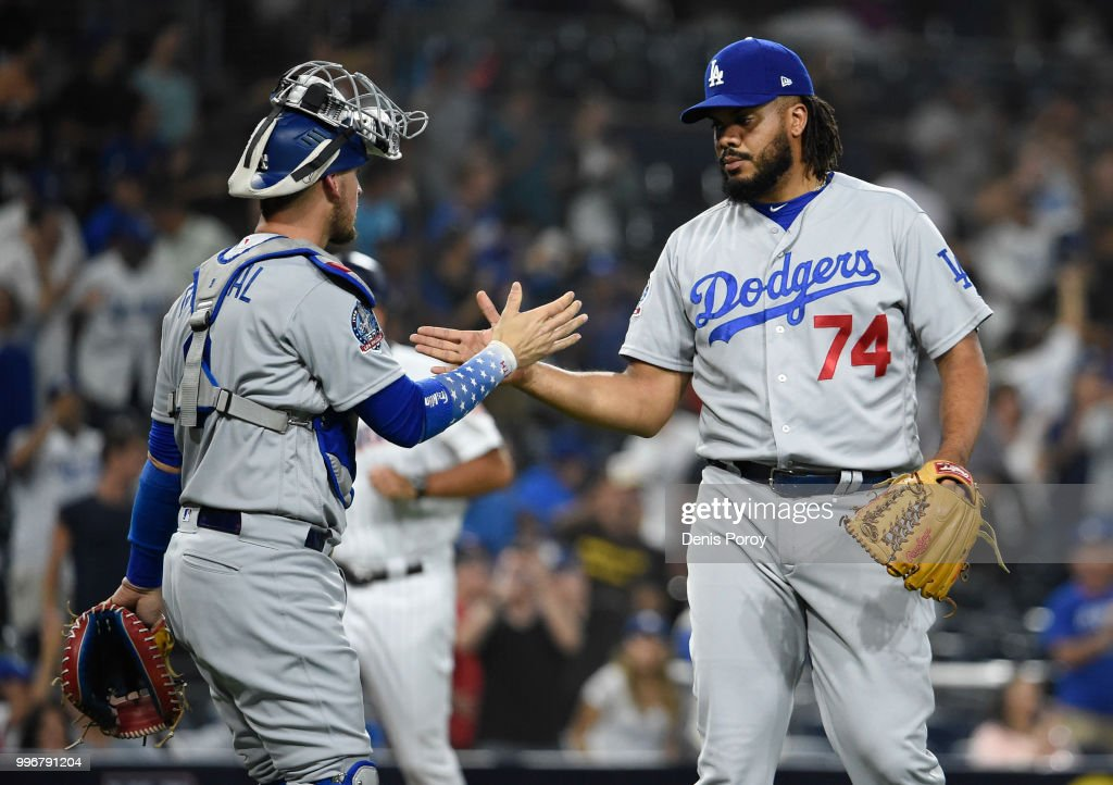 Kenley Jansen #74 of the Los Angeles Dodgers is congratulated by Yasmani Grandal #9 after beating the San Diego Padres 4-2 in a baseball game at PETCO Park on July 11, 2018 in San Diego, California.
