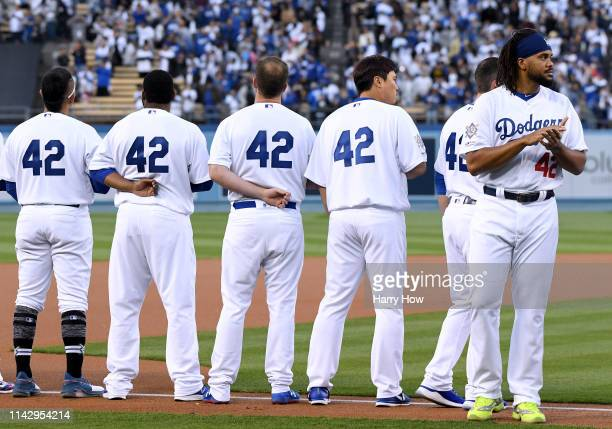 Kenley Jansen of the Los Angeles Dodgers lines up for the National Anthem before the game against the Cincinnati Reds on Jackie Robinson Day at...
