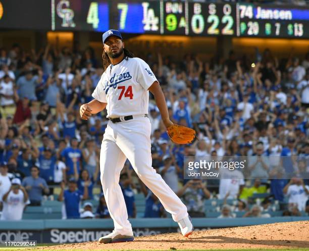 Kenley Jansen of the Los Angeles Dodgers looks toward the stands after the final out of the game against the Colorado Rockies at Dodger Stadium on...