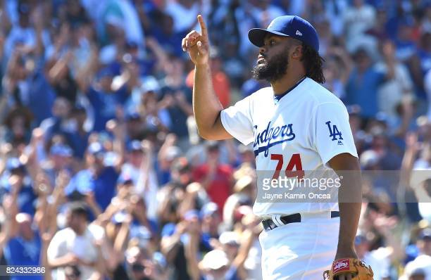 Kenley Jansen of the Los Angeles Dodgers points to the sky after throwing the final pitch of the game to strike out JaeGyun Hwang of the San...