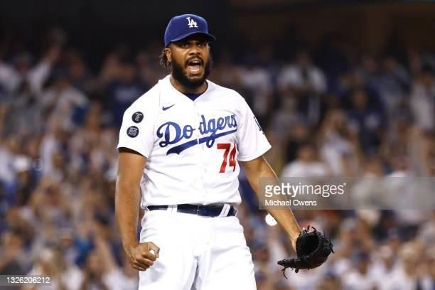 Kenley Jansen of the Los Angeles Dodgers reacts after closing out the ninth inning against the San Francisco Giants at Dodger Stadium on June 29,...