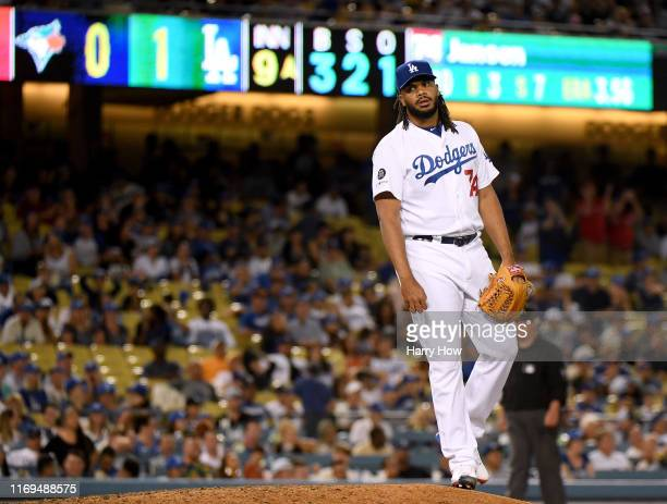 Kenley Jansen of the Los Angeles Dodgers reacts after giving up a solo homerun to Rowdy Tellez of the Toronto Blue Jays, to tie the game 1-1, during...