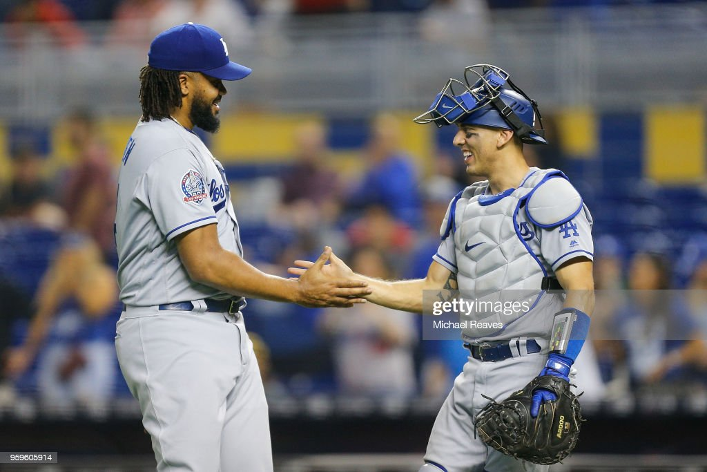 Kenley Jansen #74 of the Los Angeles Dodgers shakes hands with Austin Barnes #15 after they defeated the Miami Marlins 7-0 at Marlins Park on May 17, 2018 in Miami, Florida.