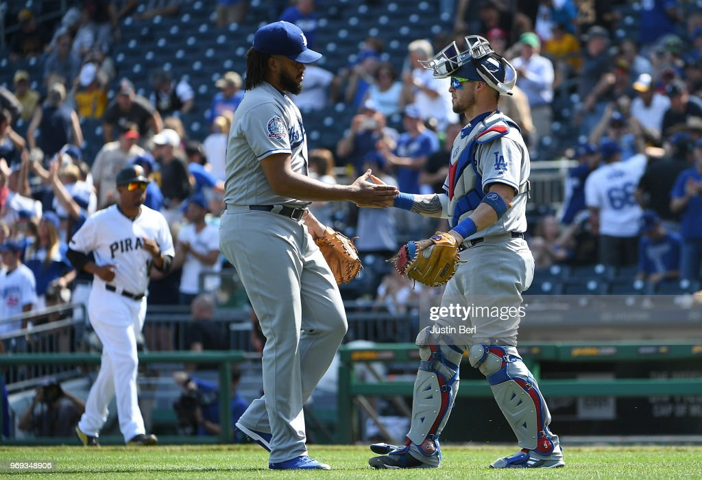 Kenley Jansen #74 of the Los Angeles Dodgers shakes hands with Yasmani Grandal #9 after the final out in a 8-7 win over the Pittsburgh Pirates at PNC Park on June 7, 2018 in Pittsburgh, Pennsylvania.