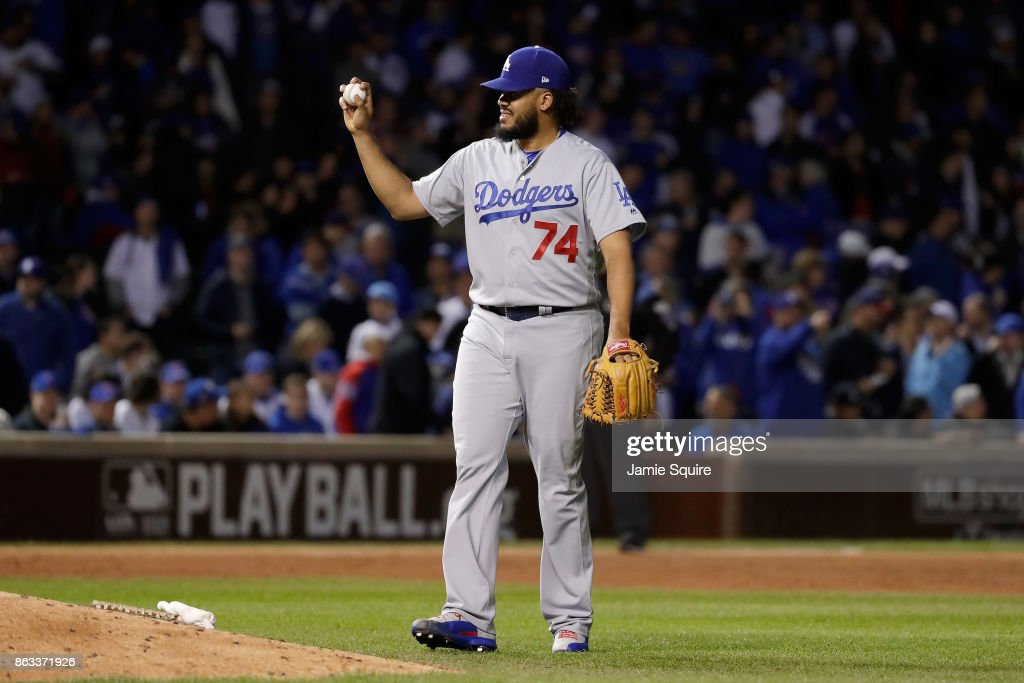 Kenley Jansen #74 of the Los Angeles Dodgers stands on the field in the ninth inning against the Chicago Cubs during game five of the National League Championship Series at Wrigley Field on October 19, 2017 in Chicago, Illinois.