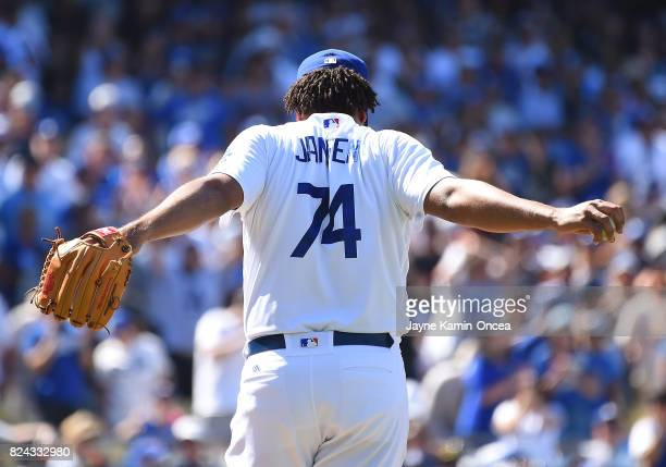 Kenley Jansen of the Los Angeles Dodgers stretches before throwing the final pitch of the game to strike out JaeGyun Hwang of the San Francisco...