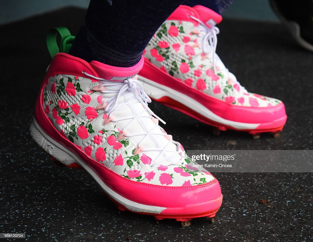 Kenley Jansen #74 of the Los Angeles Dodgers wears custom baseball shoes in honor of Mother's Day for the game against the Cincinnati Reds at Dodger Stadium on May 13, 2018 in Los Angeles, California.