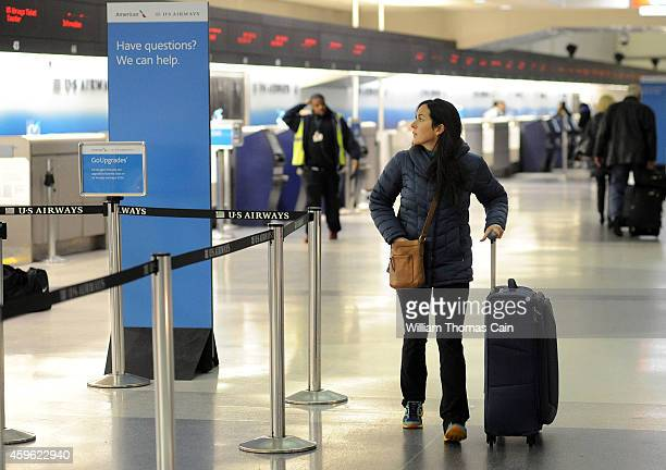 Kenna Resnich of Philadelphia Pennsylvania walks with her luggage to catch her flight to Boston Massachusetts at Philadelphia International Airport...