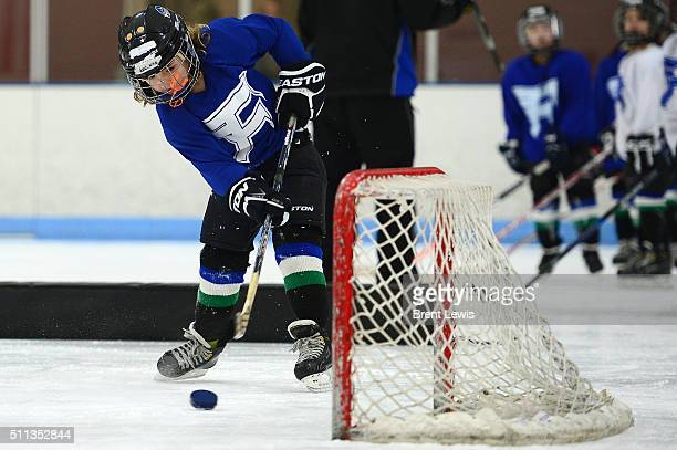 Kennan Butzen takes an easy shot on an open net during practice at Edge Ice Arena on February 17 2016 in Littleton Colorado Hockey has developed a...