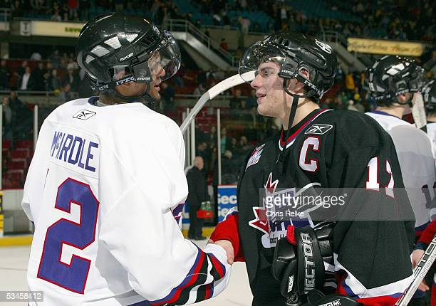 Kenndal McArdle of Team Davidson and Gilbert Brule of Team Cherry shake hands after the Top Prospects game at the Pacific Coloseum on January 19,...