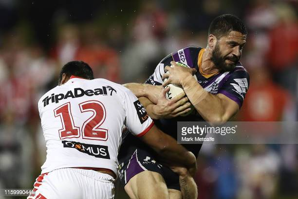 Kenneath Bromwich of the Storm Is tackled by Luciano Leila of the Dragons during the round 16 NRL match between the St George Illawarra Dragons and...