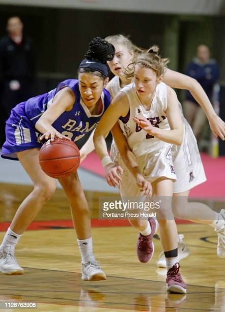 Kennebunk Isabelle Okwuosa and Greely Anna DeWolfe battle for possession in first half girls semifinal action in the MPA State Tournament at the...