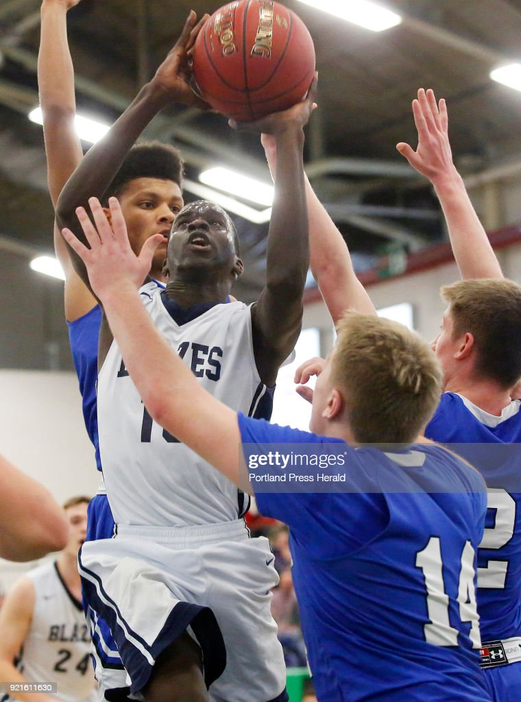 Kennebunk vs Westbrook boys Class A quarterfinal. Abier Manyiel of Westbrook works in traffic as he drives to the basket.