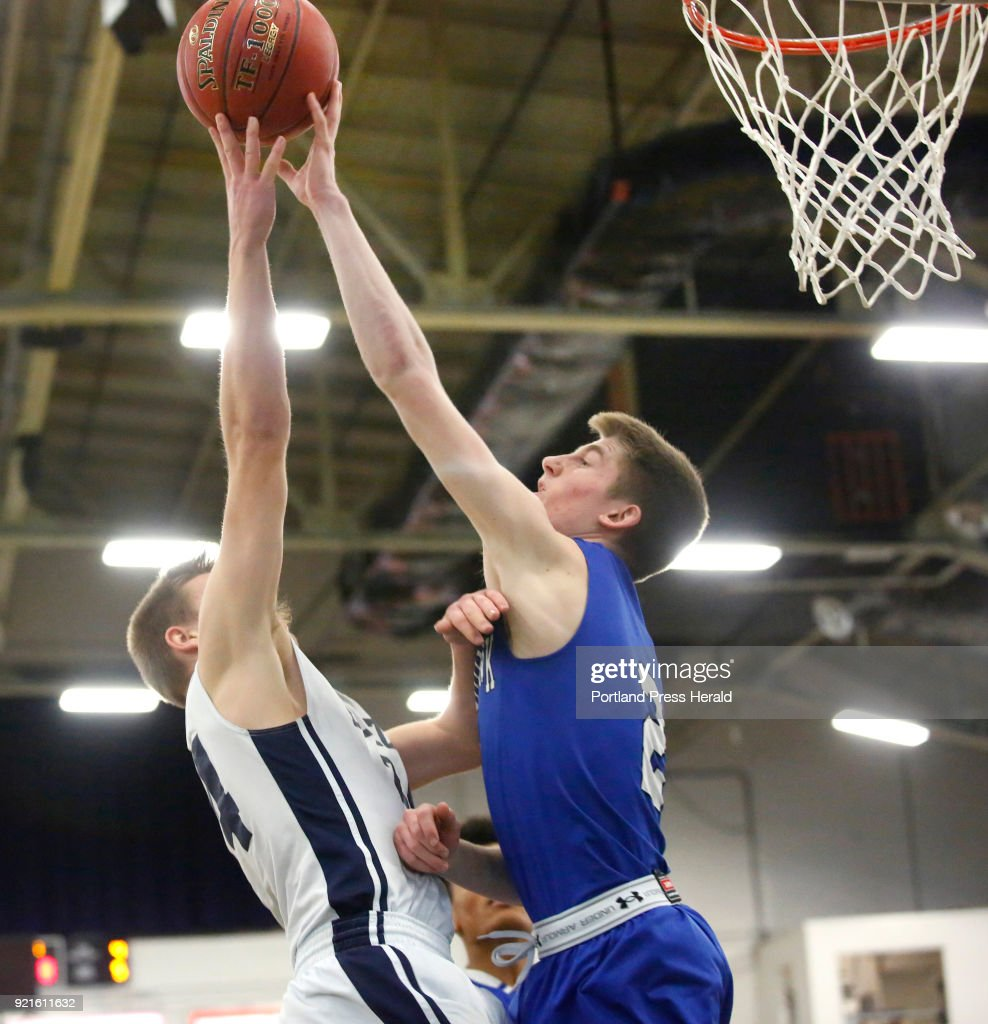 Kennebunk vs Westbrook boys Class A quarterfinal. Zachary Sullivan of Kennebunk is called for a foul as he tries to block a shot by Landon Sjoberg of Westbrook.