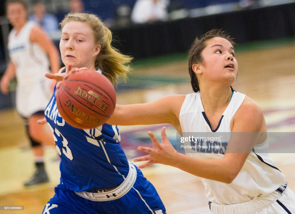 Kennebunks Emily Archibald tries to steal the ball against Yorks Jacquelyn Tabora during the Maine Class A South quarterfinals on Monday, February 19, 2018 at the Portland Expo.