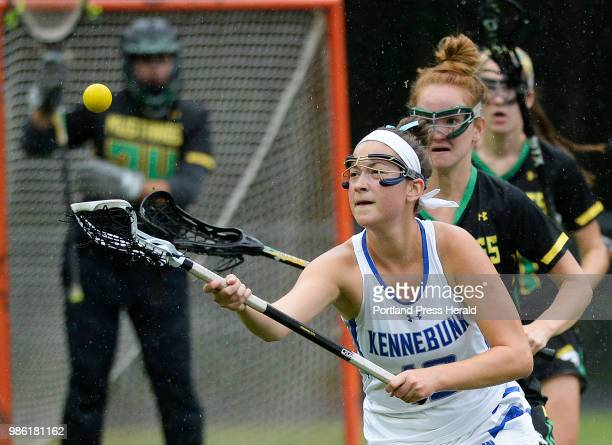 Kennebunk's Lily Schwartzman chases down a loose ball as Massabesic's Sarah DesVergnes moves in Wednesday June 13 2018