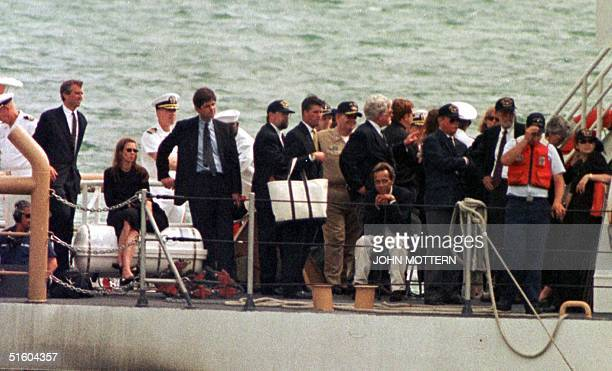 Kennedy and Bessette family members stand on the Coast Guard boat Hammerhead on their return from a burial at sea for John F Kennedy Jr Carolyn...