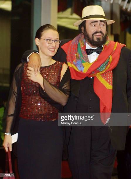 Kennedy Center honoree Luciano Pavarotti and his wife Nicoletta Mantovani arrive at the U.S. State Department building December 1, 2001 for the...