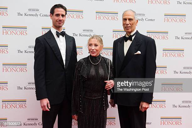 Kennedy Center Honoree Natalia Makarova center is pictured with her son Andrei Karkar left and her husband Edward Karkar as they enter the event The...