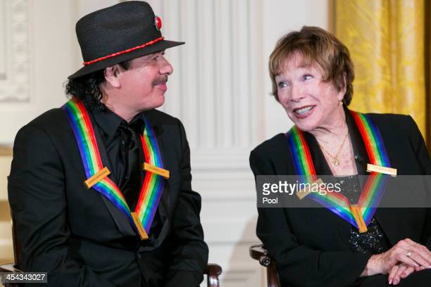 Kennedy Center Honorees Carlos Santana and Shirley MacLaine attend a reception at the White House for the 2013 Kennedy Center Honorees on December 8...