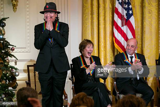 Kennedy Center Honorees Carlos Santana Shirley MacLaine and Billy Joel attend a reception at the White House for the 2013 Kennedy Center Honorees on...