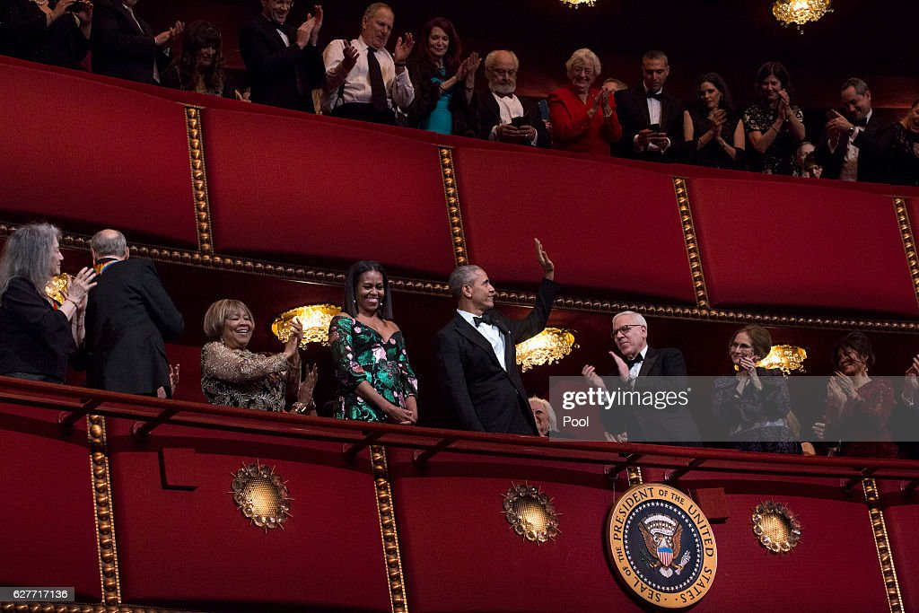 Kennedy Center Honorees pianist Martha Argerich, singer James Taylor, singer Mavis Staples, first lady Michelle Obama and President Barack Obama attend the Kennedy Center Honors show December 4, 2016 at the Kennedy Center in Washington, DC. The honorees include the band The Eagles, singer Mavis Staples, actor Al Pacino, singer James Taylor and pianist Martha Argerich.
