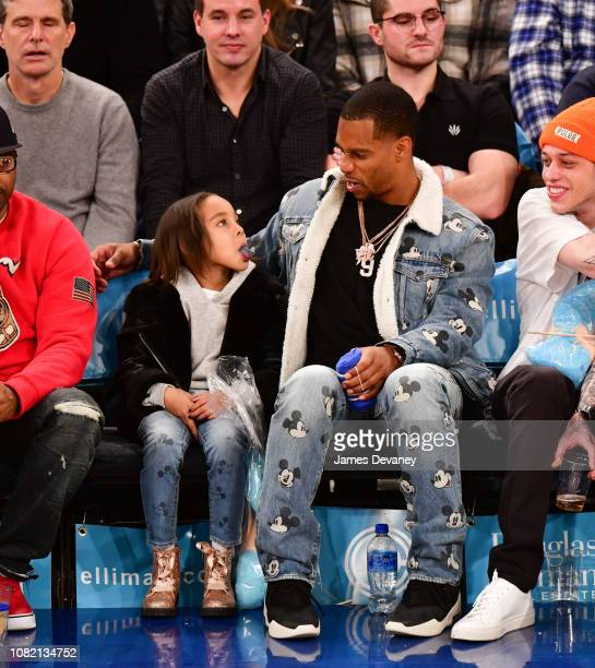 Kennedy Cruz and Victor Cruz attend Philadelphia 76ers v New York Knicks game at Madison Square Garden on January 13 2019 in New York City