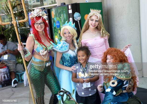 Kennedy Foust of San Diego poses with a plethora of Disney Princesses outside the Convention Center during the first day of ComicCon 2018 in San...