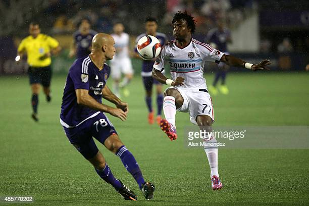 ORLANDO FL AUGUST 29 Kennedy Igboananike of Chicago Fire kicks the ball in front of Aurelien Collin of Orlando City SC during a MLS soccer match...