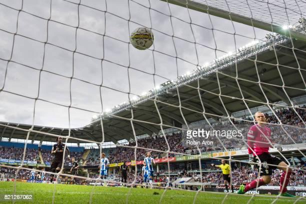 Kennedy Igboananike of Orebro SK scores 21 on penalty kick behind Pontus Dahlberg goalkeeper of IFK Goteborg during the Allsvenskan match between IFK...