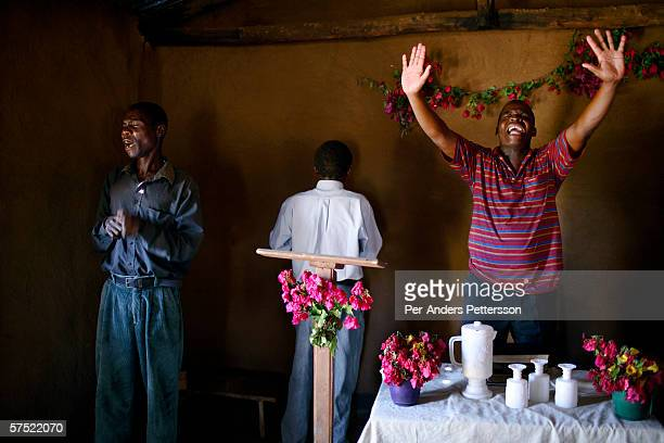 Kennedy Katapwit a pastor prays during a Sunday service at Pentecostal church on November 13 2005 in Galufu Malawi Many people come to the church to...
