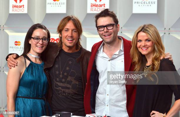 Kennedy Keith Urban Bobby Bones and Amy Brown attend the iHeartRadio Music Festival at the MGM Grand Garden Arena on September 20 2013 in Las Vegas...