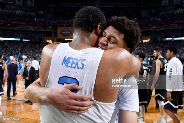 Kennedy Meeks and Brandon Robinson of the North Carolina Tar Heels embrace after time expires during the 2017 NCAA Men's Final Four National...