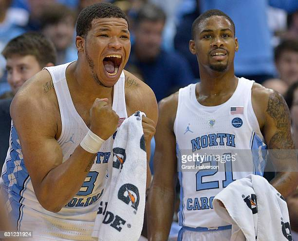 Kennedy Meeks and Seventh Woods of the North Carolina Tar Heels cheer on the reserves during the final minute of the game against the North Carolina...